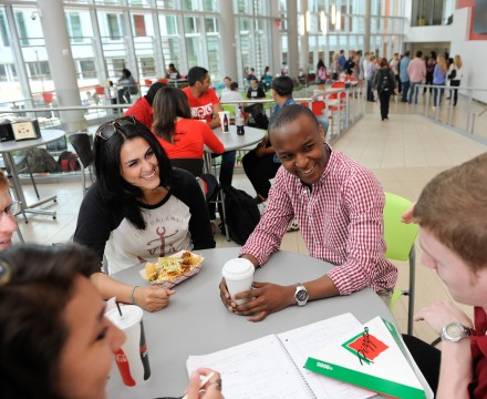 Students sit at a table in Talley Student Union discussing exams