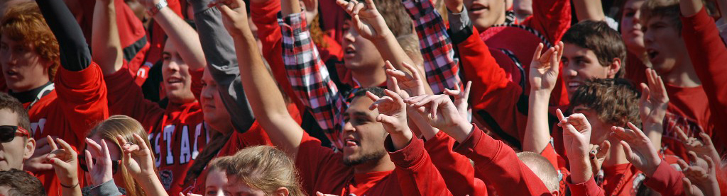 students standing during a football game in Carter-Finley Stadium