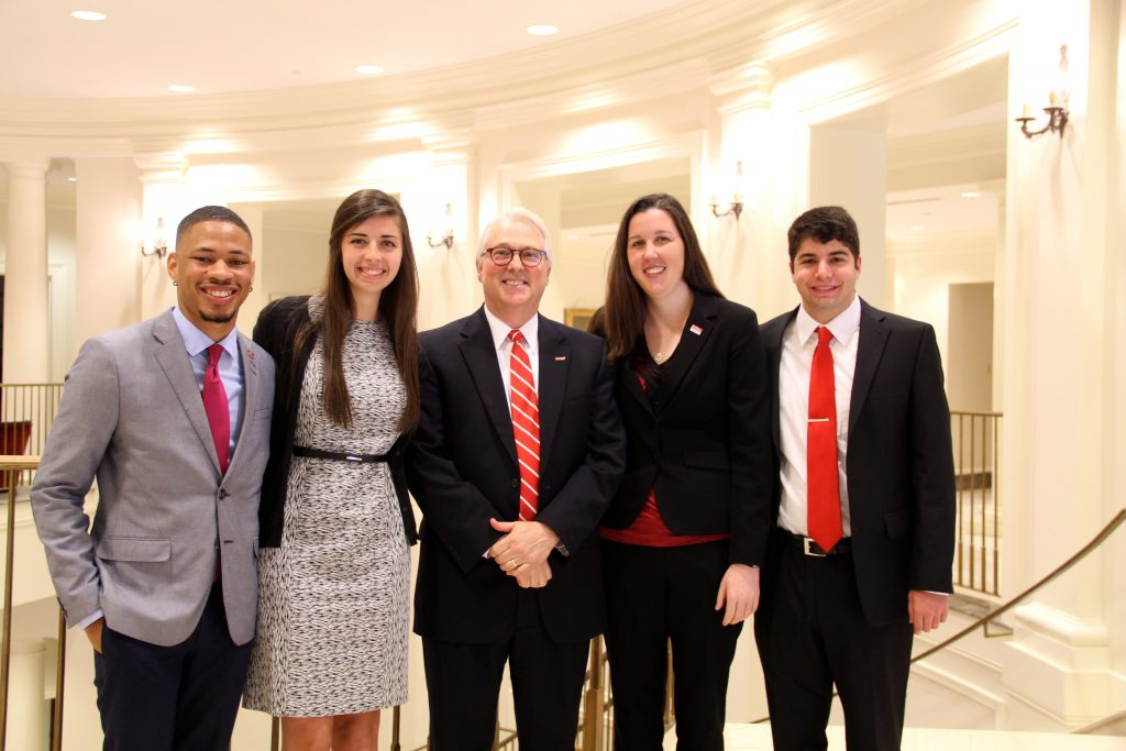 Students John Miller IV, Peyton Holmquist, Michaela Rikard, and Todd Goldfarb stand with Chancellor Randy Woodson after a meeting of the NC State Board of Trustees.