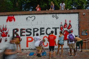 Students ready the Free Expression tunnel for the Respect the Pack event.