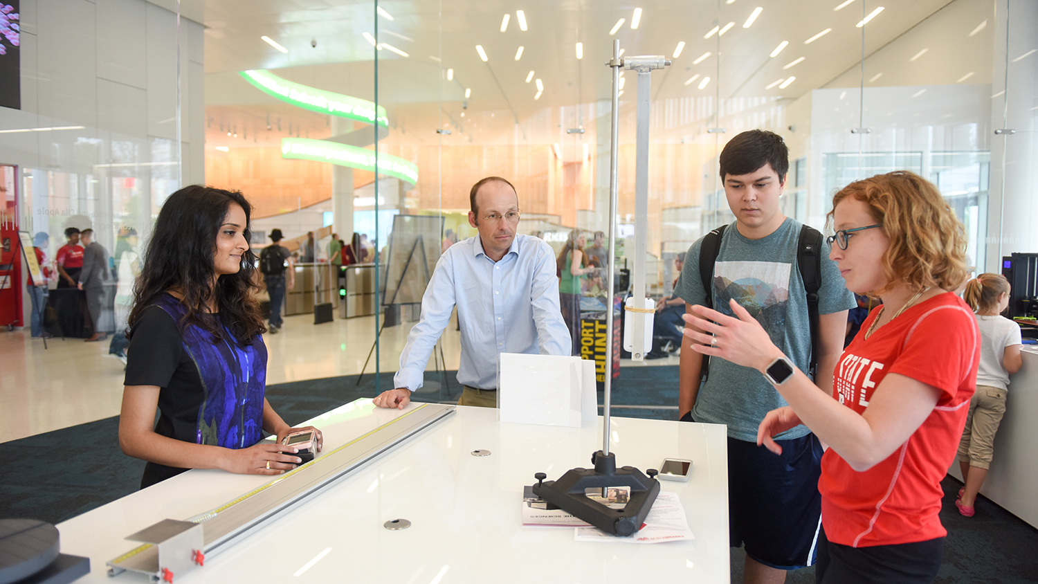 Students look at innovations on display in the lobby of NC State's Hunt Library.