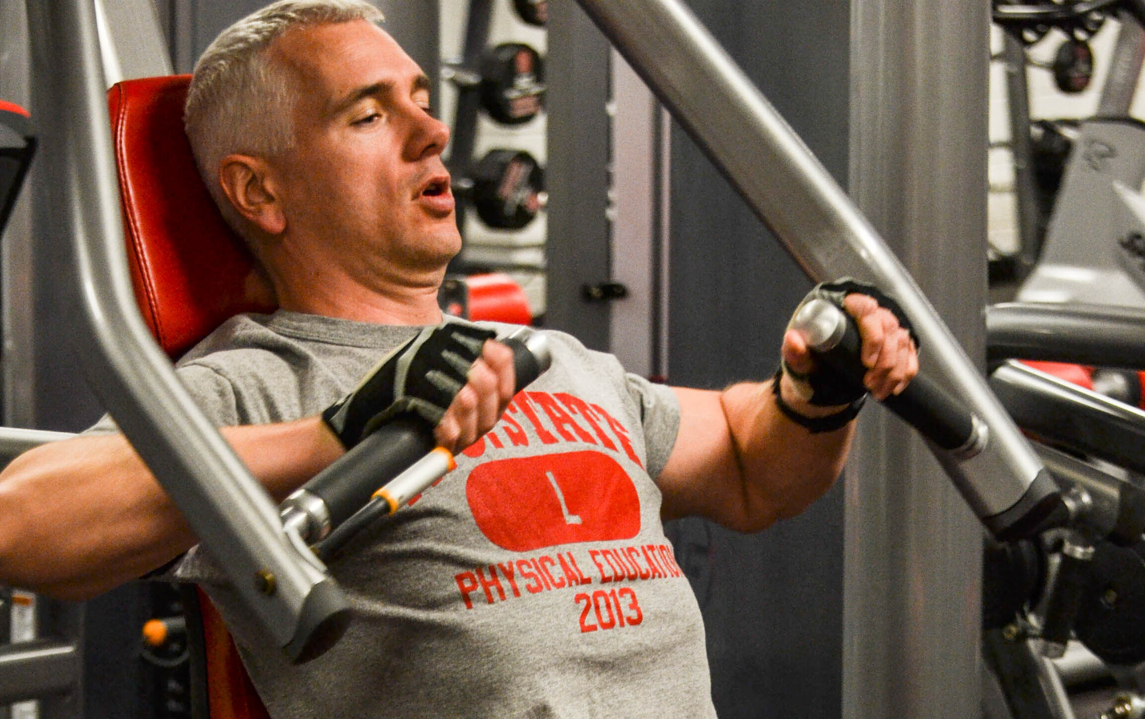 Staff and Faculty member working out at Carmichael Complex