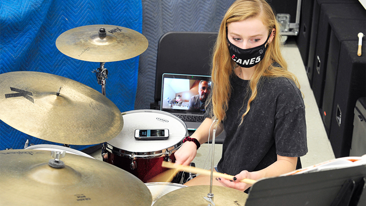 Percussion performance minor AnnE Ford attends her online drum lesson with Dr. Paul Garcia from a practice and recording space set up in Price Music Center for local students to use as needed during the fall 2020 semester of online courses. Photo by Erin Zanders.