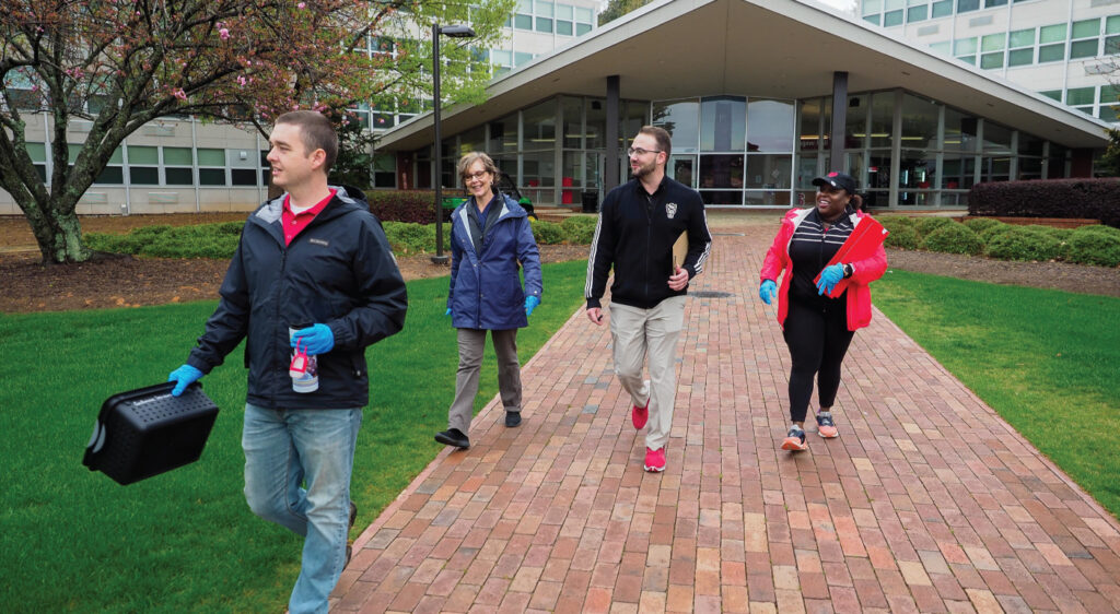 DASA staff volunteer to help housing check students out at the onset of COVID-19