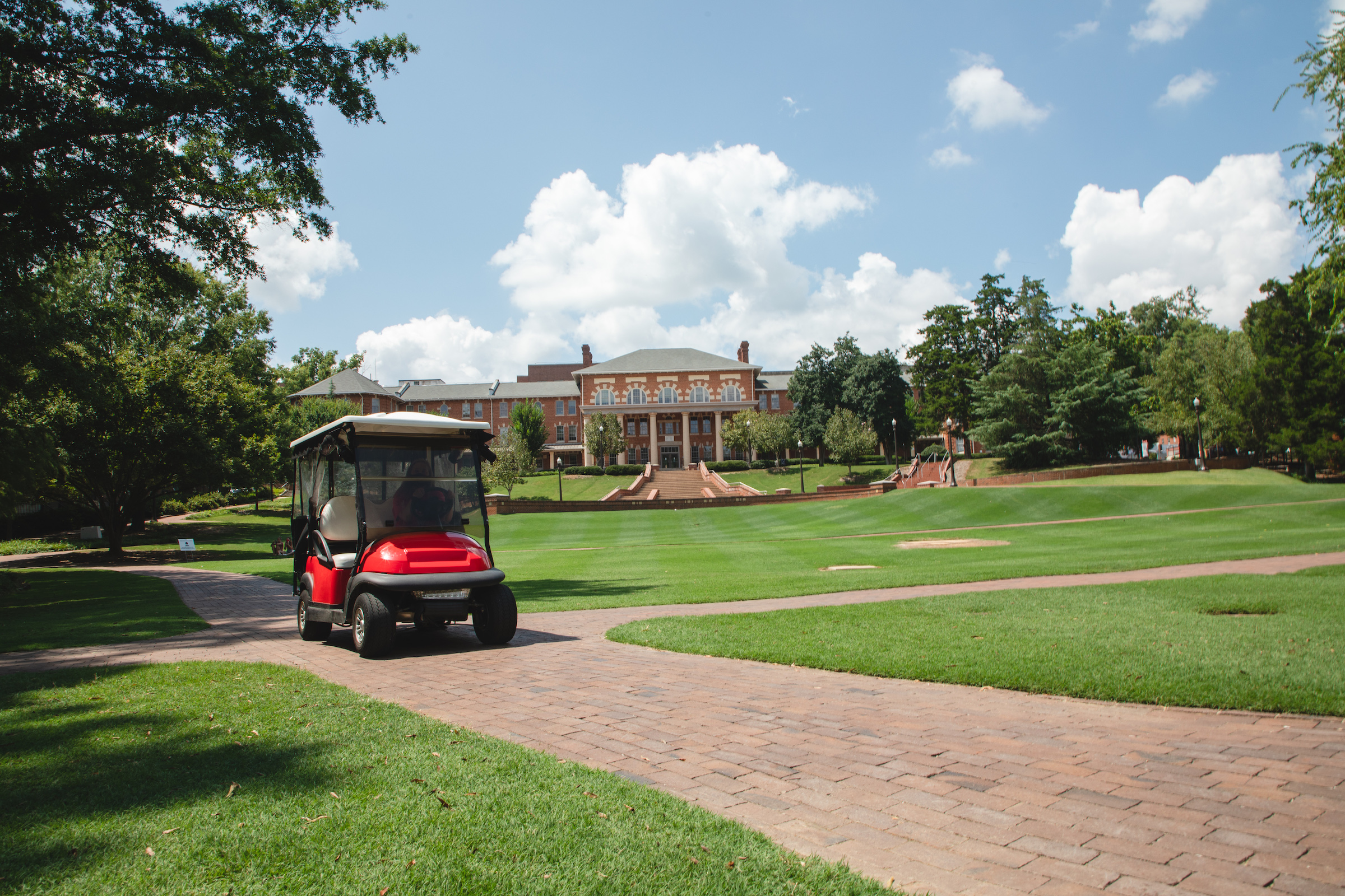 Wolfpack Pick Up golf cart driving on the Court of North Carolina