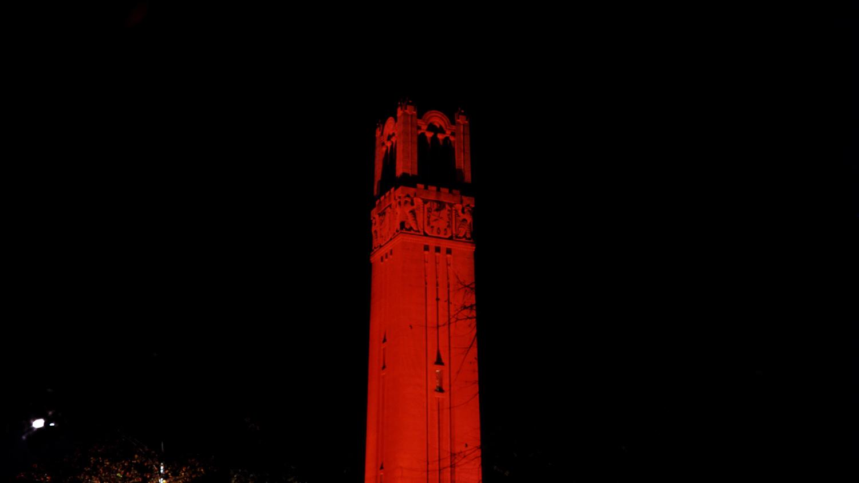 Memorial Belltower lit up red