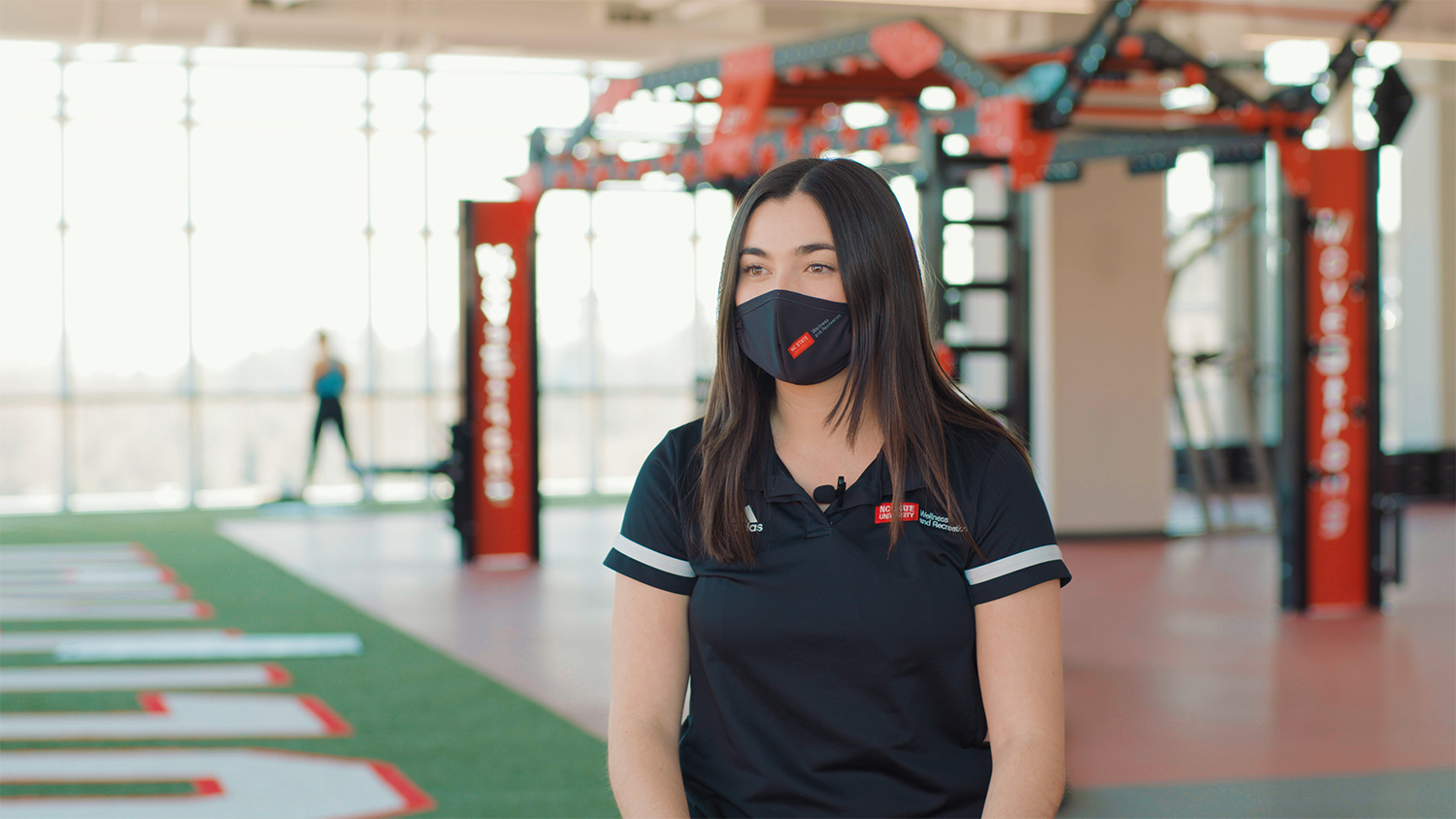 Masked student Gillian Torr in the gym of the new Wellness and Recreation Center