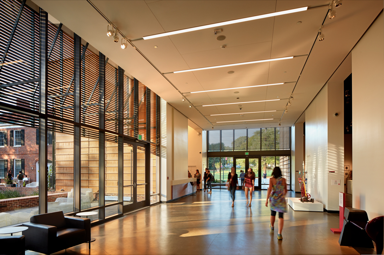Patrons walk through the grand lobby of the Gregg Museum of Art & Design