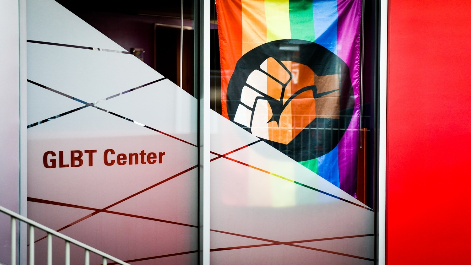 the entrance to the GLBT center adorned with a rainbow flag